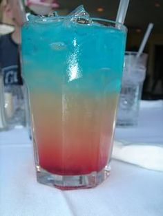 Bomb Pops: 2 oz Bacardi Razz rum, 2 oz lemonade, 2 oz Blue Curacao. It tastes just like the popsicle!