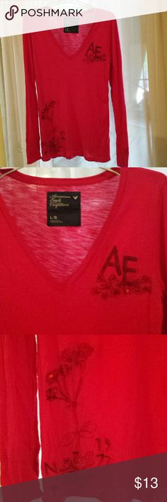 Bundle 4 For $20 American Eagle Red V-Neck Sz Lg Bundle any 4 listings marked 4 for $20, offer $20, and I will accept! Cute long sleeve t-shirt by American Eagle Outfitters. Deep V-neck. Nice detailed embroidery and sequins. In very good used condition. No tears or stains and no missing sequins. Size Large. Tops