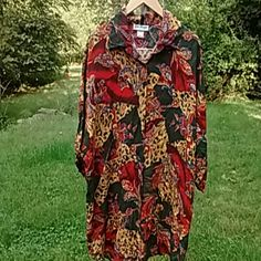 Plus size, high quality, soft unusual ladies shirt Button down, jewel tone colors. Mix of animal print and paisley. Very gently used. Geri Marque Tops