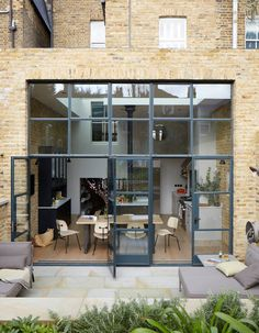 A little bit industrial, a little bit English country, this Victorian south London home has exposed brick walls, Crittall doors and a country kitchen. Steel Doors And Windows, Metal Windows, Industrial Windows, Metal Roof, Large Windows, Victorian Terrace, Victorian Homes, Crittal Doors, Crittall Windows