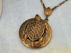 brass locket, turtle locket, UNDER THE SEA, antiqued brass turtle floral locket necklace Silver Locket Necklace, Silver Lockets, Sterling Silver Earrings, Pendant Necklace, Coral Earrings, Pink Opal, Brass Chain, Under The Sea, Antique Brass
