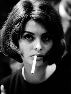 Sophia Loren smoking a cigarette, 1960s.