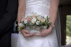 A wedding clutch bag full of flowers, Kingston Bagpuize house, Joanna Carter wedding flowers