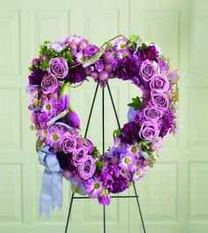 Purple Wreath Arrangements | ... wreath offers a heartfelt expression of sympathy heart shaped wreath