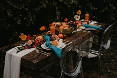 Fun pop of color with these Turquoise Linnea Napkin and bright orange centerpieces by She Said Yes Events