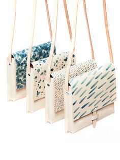 MYR Studio Rain Bag // these leather cross-body messenger style bags feature artistic prints in a watercolor style.
