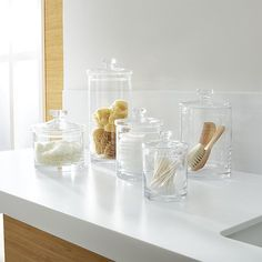 Sale ends soon. Shop Set of 5 Glass Canisters. Simple bathroom storage with a retro feel. Handmade glass canisters with nesting lids update a classic apothecary look. Apothecary Jars, Clear Glass Canisters, Crates, Glass Bathroom, Simple Bathroom Decor, Bathroom Accessories Sets, Glass Canister Set, Glass, Glass Canisters