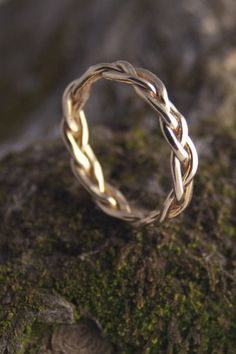 Gold braided ring!! Beautiful would go perfect with a solitaire diamond ring...this would be cute. #diamondrings
