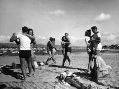 Teenagers dancing on the beach, 1950s