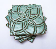 Hey, I found this really awesome Etsy listing at http://www.etsy.com/listing/59241540/aqua-pottery-coasters-handmade-set-of-4