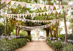 Greg's mum not only made the absolutely magic Liberty-print bunting we had hanging between the trees lining the driveway entrance to the property, she made 150 metres of it!