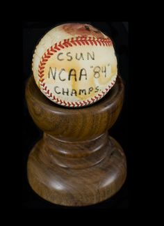 A photograph of the official California State University, Northridge (CSUN), 1984 NCAA Championship baseball, signed by the CSUN team. CSUN University Archives.