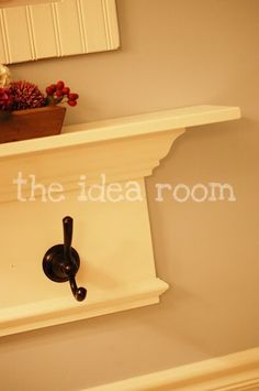 This is pretty much what we did for the coat hooks in the entryway. Maybe we could do one in the bathroom?