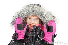 Little girl dressed in ski wear standing and isolated  on white background.
