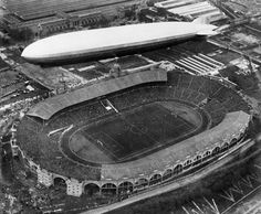 LZ127 Graf Zeppelin 1930-04-26 London flying over Wembley Stadium, while the football cup final match between Huddersfield and Arsenal was in progress