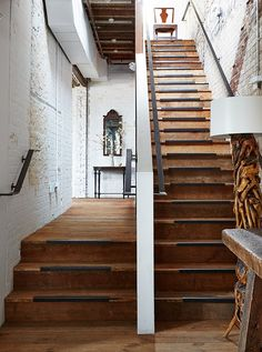 On the first level, the floors, ceiling trusses, and main staircase are made from wood salvaged from a former South African embassy built around the same pre-Civil War period as the building that houses Darryl's boutique.