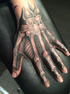 Skeleton hand tattoo by Alex Frew at Axonic Inkworks
