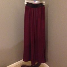 Maxi skirt Quinn Skirt size small. Deep purple maroon in color with black band around the waist. 100% polyester. 42 inches in length with a slit up the side. Quinn Skirts Maxi