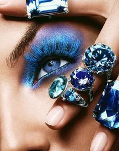 Here blue lashes play an equel role in creating this trendy eye look. More for the runway not real way..but you can add this feel and fun into an everyday makeup look. Do a sheer wash of blue on the lid and then add the blue flare lashes! Gene Juarez