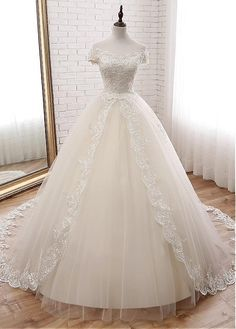 Buy discount Attractive Tulle Off-the-shoulder Neckline Ball Gown Wedding Dress With Lace Appliques & Beadings at Dressilyme.com