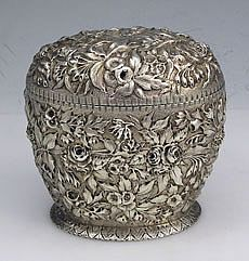 A large oversize oval repousse hand chased 11 oz tea caddy by S Kirk & Son. Finely hinged lid and hand chased and engraved decoration of multiple flowers and leaves. My silver flatware is by the same company. just exquisite! Vintage Silver, Antique Silver, Teapots And Cups, Teacups, Tea Tins, Antique Boxes, Tea Caddy, Silver Spoons, Tea Service