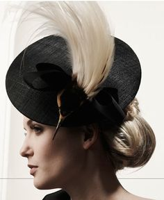 yvete jelfs work s extrodinary ,he creates hats which are like illuions i like this one especially as it looks as if there is a bird stuch inbertween the bow with  its feathers coming throught.