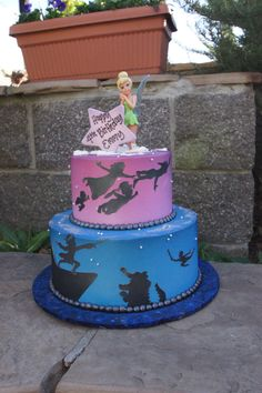 Blue and purple Peter Pan themed birthday cake