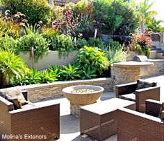 This patio has a fire bowl with poured in place, concrete seating area