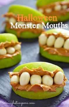 Halloween monster mouths! Just apples, peanut butter and yogurt raisons. Perfect healthy Halloween snack.