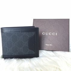 Men's Gucci wallet Brand new men's authentic Gucci wallet, leather and canvas. 8 card slot holders, 2 open long pockets for cash, and 2 extra side pockets under the slot holders. All black, might even look dark gray the canvas part. Retails $320 + tax. ✔️mercari available for $265 Gucci Bags Wallets