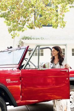 Designer Katie Kime rides around townin a 1975 Ford Bronco that's parked outside her home.