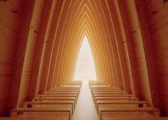 Copper-clad chapel in Finland has a curving wooden frame