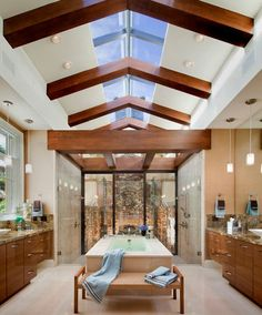 There are several choices when it comes to vaulted ceiling lighting fixtures. Vaulted ceiling lighting ideas often include skylights. Skylight Bathroom, Bathroom Fireplace, Spa Like Bathroom, Asian Bathroom, Modern Bathroom, Bathroom Layout, Bathroom Interior, Bathroom Ideas, Serene Bathroom