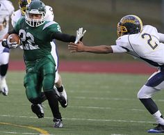 Edmonds-Woodway's Desmond Young sprints down the field as Mariner's Dan Nadat tries to stop him. See more of Seattle Times photographer Colin Diltz's photos from the game.