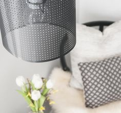 Metal screen becomes a pendant light's drum shade.  Great tutorial.