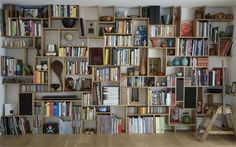 15 DIY Crate Bookcase Ideas. I would like to do this one, but with the shelves and the wall painted a creamy white.