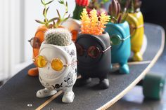 Last year we featured these little menacing yet totally adorable concrete-art toys and now they've expanded to not only haunt your home or workspace but house your favorite succulent or cactus! You can customize the monster pot in several ways. Spray paint your own design, apply temporary tattoo stickers, or give em' some UM sunglasses. Then, let your plant be the monster's hairstyle!