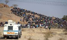 Also in South Africa a police vehicle takes position as miners stage a sit-in close to a platinum mine in Rustenburg, 100 km northwest of Johannesburg today. Ten people were killed in clashes at the mine between rival unions, the National Union of Mineworkers (NUM) and the smaller Association of Mineworkers and Construction Union (AMCU). Eight Lonmin employees died, while two of the police officers sent to quell the unrest were killed in two days of violence which started off as an illegal…