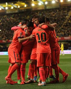 Neymar of FC Barcelona celebrates with teammates after scoring his team'sb opening goal during the Copa del Rey Semi-Final, Second Leg match between Villarreal CF and Barcelona at El Madrigal stadium on March 4, 2015 in Villarreal, Spain.