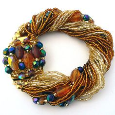 http://www.muranoglassgifts.com/bracelets/murano-glass-bracelet-gold-P2641.html Murano Glass Bracelet- One of  100s of Bracelets pieces from Murano Glass Gifts Co.Shop our collection today and get FREE Shipping on your order!