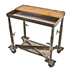 unique well-constructed depression era american antique industrial mobile chicago factory work table or cart with recessed tool or parts tray and cast iron casters