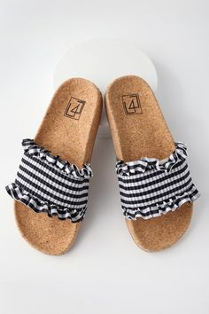 There is only one word to describe our feelings toward the LFL Alexa Black Gingham Slide Sandals, and it is OBSESSED! A smocked, black and white gingham toe strap has cute, ruffled trim. A trendy, cork insole completes the chic look.