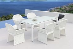 7 Piece patio set made of wicker frame on the table base and legs, and chairs frame. Black cushion fabric on patio seats that sustain typical outdoor weather. Outdoor Dining Furniture, Outdoor Dining Set, Patio Furniture Sets, Wicker Furniture, Outdoor Decor, Dining Sets, Round Dining, White Dining Chairs, Patio Dining Chairs