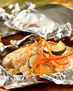 Foil-Wrapped Fish with Creamy Parmesan Sauce -- In this recipe, tender fish fillets are topped with mayonnaise, Parmesan cheese and crisp vegetables, then wrapped in foil packets for easy grilling.