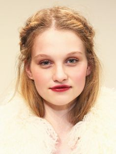 Fishtail braids, an off center part, and crimson lips make for an absolutely dreamy makeup look