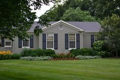 Grey painted brick ranch house, love the color and the shutters