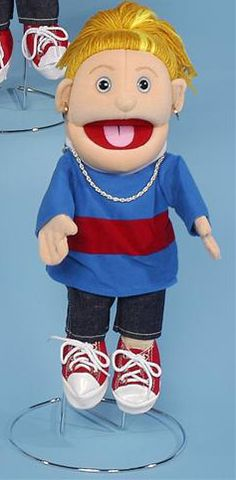 The blue shirt that this girl puppet is wearing has a red and white stripe through the chest. She never leaves home without her silver earings and necklace.