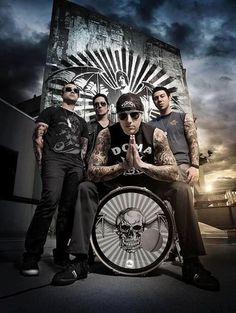 Avenged Sevenfold with The Rev in the background
