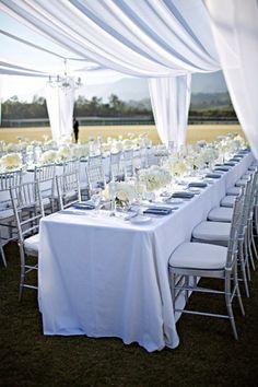 Beautiful tables-cape for a lovely, elegant, and relaxing wedding.   * Would also look great indoors with a lot of lights draping through the white cloth.