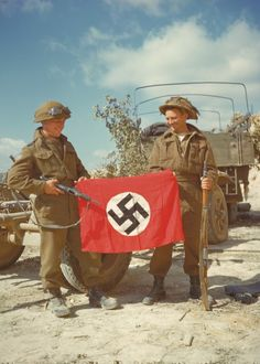 Canadian soldiers with a Nazi German flag which they captured during the Battle of Normandy.This is on my bucket list.to visit Normandy Canadian Soldiers, Canadian Army, British Army, British Soldier, Canadian History, American Soldiers, World History, World War Ii, Ww2 History